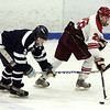 Gloucester: Gloucester's Salvatore Taormina keeps the puck ahead of Peabody's Matt Rodgers during the hockey game at the Dororthy Talbot Rink Wednesday night. Mary Muckenhoupt/Gloucester Daily Times