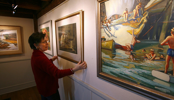 Rockport: Carol Linsky, Executive Director of the Rockport Art Association, hangs a painting by George Quackenbush as the museum prepares for its reopening. There will be an opening reception tonight from 5-7 and will be open Wednesday - Friday from 10am-4pm, Saturday from 10am-5pm and Sunday from noon-5pm. Photo by Kate Glass/Gloucester Daily Times