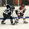 Gloucester: Gloucester's Conor Ressel and Peabody's Ryan Noftle fight for possession of the puck during the hockey game at the Dororthy Talbot Rink Wednesday night. Mary Muckenhoupt/Gloucester Daily Times
