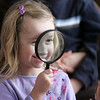 "Gloucester: Ella Merritt, 4, left, and Sarah Fernandes, 2, look at each other through magnifying glasses during Snowflake Shapes and Science Hosted by the Trustees of Reservations as part of ""February School Vacation - Exploration!"" at the Cape An Discovery Center at Ravenswood Park Wednesday afternoon. The kids learned they could use magnifying glasses  to check out snowflakes the next time it snows. Mary Muckenhoupt/Gloucester Daily Times"