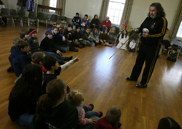Manchester: Jack Mullarkey of 3MB Fencing asks the audience what the differences are between two types of fencing swords, foil and epee, during a program sponsored by the Manchester Public Library yesterday. Photo by Kate Glass/Gloucester Daily Times