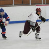 Gloucester: Rockport's Pat Hofmann breaks away from Minuteman defenders to take possession of the puck during the hockey game at Dorothy Talbot Rink Saturday afternoon.  Mary Muckenhoupt/Gloucester Daily Times
