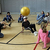 Manchester: Kyle Silva heads the ball as he and his 7th grade classmates from the O'Maley Middle School play soccer doing the crab walk while participating in the enrichment program at the Manchester Athletic Club on Wednesday. The students learned about nutrition and physical fitness during the program. Photo by Kate Glass/Gloucester Daily Times