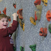 Manchester: First grader Finn Carlson climbs the rock climbing wall in Chris Lamothe's gym class at Manchester Memorial Elementary School Wednesday afternoon. Mary Muckenhoupt/Gloucester Daily Times