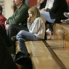 Rockport: Macie Wayrynen, 7, eats an ice-cream cone while sitting with her dad, Chris, and watching her brother's sixth grade youth basketball game at Rockport High School Saturday afternoon. Mary Muckenhoupt/Gloucester Daily Times