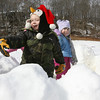 Rockport: Riley Blanchard, left, and Lauren O'Connor, 4, throw snowballs from inside their fort at Evans Field on Wednesday. Photo by Kate Glass/Gloucester Daily Times