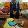 Gloucester: Sarah Hackett of Annisquam, who founded Haiti Projects Inc., displays several items made by women in the nonprofit's sewing and knitting cooperative. Hackett was in Haiti when the earthquake hit and just returned to Gloucester over the weekend. Photo by Kate Glass/Gloucester Daily Times