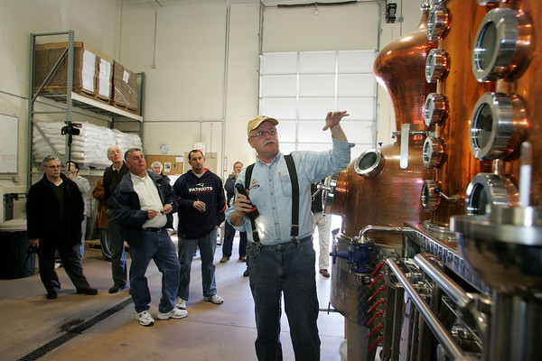 Gloucester: Jim Cook, a distiller at Ryan and Wood Distillery, shows people the process of making rum during a reception held for the unveiling of the new rum they are selling. Mary Muckenhoupt/Gloucester Daily Times