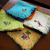 Gloucester: Samples of napkins embroidered by women who work for Haiti Projects Inc., which was founded by Gloucester resident Sarah Hackett. The nonprofit gives Haitian women a means to earn money with the hope that they will be self-sustaining. Photo by Kate Glass/Gloucester Daily Times