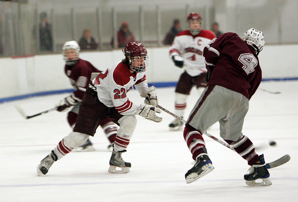 Gloucester: Gloucester's Johnny Interrant tries to steal the puck from Arlington's Dillon Wright during the hockey game at Dorothy Talbot Rink Wednesday night. Mary Muckenhoupt/Gloucester Daily Times