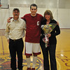 Gloucester: Gloucester's Capt Jim Nicolosi posses for a photo with his parents Tom and Peggy for senior night before the game aganist Danvers, last night at the Benjiamin A Smith Field House. Desi Smith Photo/ Gloucester Daily Times. February 16,2010.