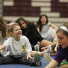 Gloucester: Ariana Smith, 6, stretches with her friends and cherrleaders at the mini cheerleader's camp at Gloucester High School Thursday afternoon.  Mary Muckenhoupt/Gloucester Daily Times