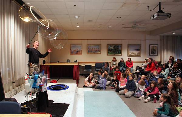 Rockport: Bubble artist Keith Michael Johnson makes giant bubbles at the Rockport Public Library Saturday morning.  Johnson explained the fun, scientific properties of bubbles with a few experiments and showed the kids that a bubble can indeed be shaped like a square. The program was funded by the Friends of the Rockport Public Library. Mary Muckenhoupt/Gloucester Daily Times