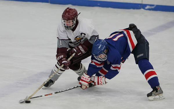 Gloucester: Rockport's Brendan Douglas, left, and Minuteman's Mike Kelleher fight for possession of the puck during the hockey game at Dorothy Talbot Rink Saturday afternoon.  Mary Muckenhoupt/Gloucester Daily Times