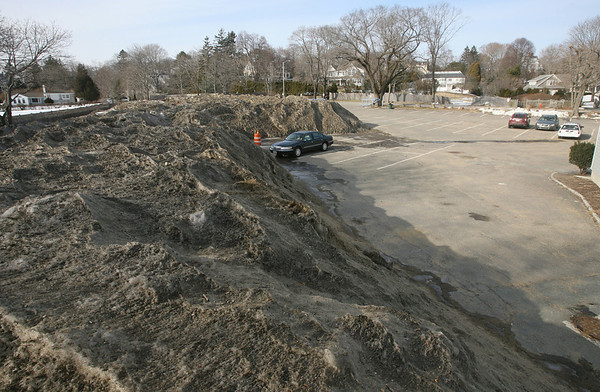 "Manchester: Several Manchester residents have expressed concern that the piles of snow in the Singing Beach parking lot are taking up too many spaces, particularly in the ""resident only"" section. Photo by Kate Glass/Gloucester Daily Times"