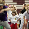 Gloucester: Allie Rose Nicastro, 5, watches the cheerleader in front of her before trying any of the moves during a mini cheerleader's camp held at Gloucester High School Thursday afternoon. Mary Muckenhoupt/Gloucester Daily Times