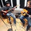 Gloucester: Tom Pearce, left, and Chris Armstrong rehearse for a music and dance benefit for Healing Abuse Working for Change, which will be at Gloucester Stage on February 6th. Photo by Kate Glass/Gloucester Daily Times