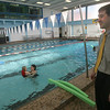 "Gloucester: Scott Hitchcock, the new Executive Director of the Cape Ann YMCA, watches as members enjoy ""Family Swim"" at the pool. Hitchcock said he has been getting to know all the staff members and is looking forward to meeting the community to find out how the YMCA can improve to meet their needs. Photo by Kate Glass/Gloucester Daily Times"