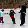 "Gloucester: Brendan Anderton pulls his daughter, Brittney Anderton, 7, and Keith Trefry, 10, around on the ice at Buswell Pond Tuesday afternoon. It was their first time out on the ice this year and Keith's skates didn't fit, but he still wanted to ""skate."" Photo by Kate Glass/Gloucester Daily Times"