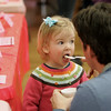 Manchester: Penelope Riggs, 2, takes a bite of apple pie ice-cream while sharing with dad at the ice-cream social fundraiser for Haiti hosted by Captain Dusty's Ice Cream at the Manchester Community House Saturday afternoon. Mary Muckenhoupt/Gloucester Daily Times