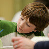 Gloucester: Anders Landgren, 7, works on painting his green bowl during the bowl decorating event at The Open Door Food Pantry Thursday night. Mary Muckenhoupt/Gloucester Daily Times