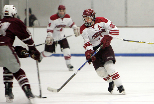 Gloucester: Gloucester's MacKenzie Quinn stick handles past Arlington's Joseph Stanton during the hockey game at Dorothy Talbot Rink Wednesday night. Mary Muckenhoupt/Gloucester Daily Times