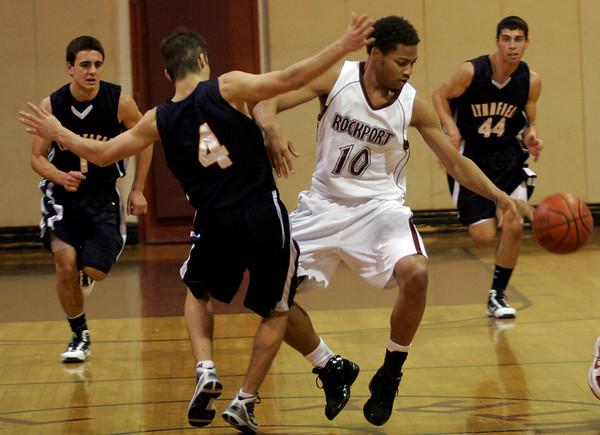 Rockport: Rockport's CJ Dowdell dribbles around Lynnfield's Andy Milinazzo during their game at Rockport High School last night. Photo by Kate Glass/Gloucester Daily Times