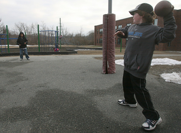 "Rockport: Jakob Wessel, 10, throws a football to Ron Pinkard, 9, at Rockport Elementary School Wednesday afternoon. Although both were good at throwing and catching, Jakob says Ron is the better quarterback. ""He's got a good arm,"" he said. Photo by Kate Glass/Gloucester Daily Times"