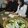 Gloucester: Bob Hope and Jessica Hinckley, both volunteers, fill grocery lists at the Cape Ann Open Door Food Pantry yesterday afternoon. The non-profit purchased the Emerson Ave. building it has been renting from Wellspring, Inc. Photo by Kate Glass/Gloucester Daily Times