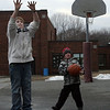 Rockport: Dustin Karalfa, 12, and Roy Gebhardt, 5, play basketball outside Rockport Elementary School during the YMCA's after school program on Wednesday. Photo by Kate Glass/Gloucester Daily Times<br /> , Rockport: Dustin Karalfa, 12, and Roy Gebhardt, 5, play basketball outside Rockport Elementary School during the YMCA's after school program on Wednesday. Photo by Kate Glass/Gloucester Daily Times