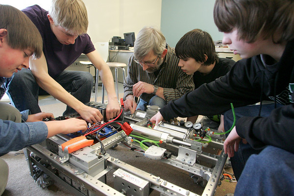 Gloucester: From left, Sean Halloran, Greg Neff, Denis Carlberg, Sam Carlberg and Loyd Waites work on the finishing touches to the robot the robotics team Manchester Essex High School will bring to their upcoming competition at Boston University in March. Mary Muckenhoupt/Gloucester Daily Times