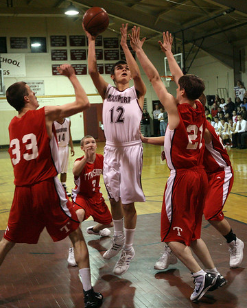 Rockport: Rockport's Tommy Burnham shoots over Tyngsborough's Sam McGrath and Chuckie Keenan during their win in the first round of the MIAA Division IV North Tournament at Rockport High School last night. Photo by Kate Glass/Gloucester Daily Times