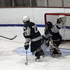 Gloucester: Mackenzie Quinn knocks the puck past Dennis-Yarmouth's Matt Tierney and goalie Mike Lambias for a goal during their 9-1 win at the Talbot Rink last night. Photo by Kate Glass/Gloucester Daily Times