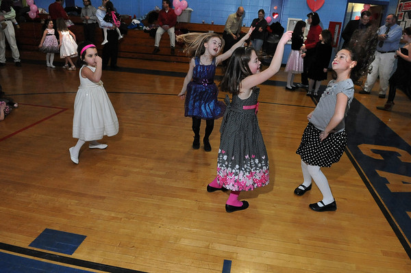 """Gloucester: (Girls just wanta have fun!)   Bailee Militello 5,(left) does the swim, while Lily Marshall 7, Kelsey Lowthers 8, and Martina Gallo 7, dance their own modern style of dance, to the music by DJ Tony """"D"""" Saturday night at the YMCA's Father Daughter Dance. Desi Smith/Gloucester Daily Times. February 12,2011."""