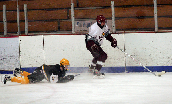 Gloucester: Rockport's Jake Leblanc skates past Boston Latin Academy's Mike Clough during their 4-1 win at the Dorothy Talbot Rink yesterday. Photo by Kate Glass/Gloucester Daily Times