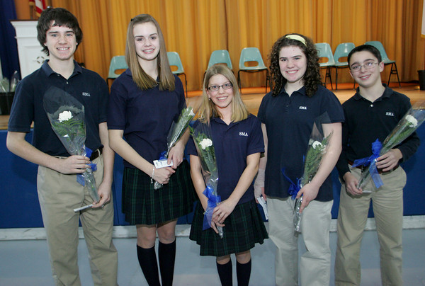 Danvers: From left, Kyle Sarazin, Rebecca Brackett, Bianca Tocco, Amy Geraghty and Barry Mohan, all from Gloucester, were inducted into the Junior National Honor Society at St. Mary's of the Annunciation School in Danvers in a ceremony after school Tuesday afternoon.  The seventh and eighth grade students were selected based on their scholarship, leadership, service, citizenship and character.  Mary Muckenhoupt/Gloucester Daily Times