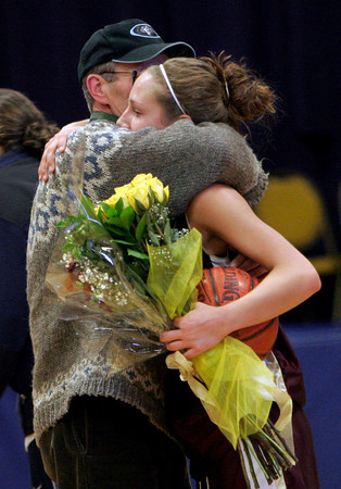Lynn: Hannah Cain hugs her father, Tom, after scoring her 1,000th career point during Gloucester's game against Tewksbury at St. Mary's High School in Lynn yesterday. Photo by Kate Glass/Gloucester Daily Times