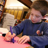 Manchester: Matt Russo makes a valentine for his mother at the Manchester Library on Wednesday afternoon. Photo by Kate Glass/Gloucester Daily TImes