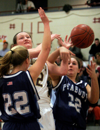 Gloucester's Audrey Knowlton gets fouled by Peabody's Brittany LeFave, right, during their game at the Benjamin A. Smith Fieldhouse last night. Photo by Kate Glass/Gloucester Daily Times