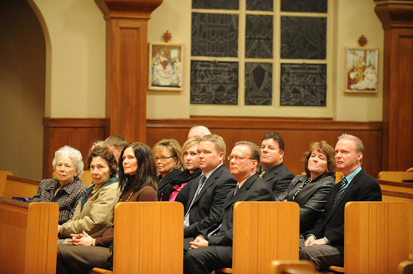 Gloucester: Family members of  Father Alves listen as he recalls his beginings at Our Lady of Good Voyage Wednesday nights service. Desi Smith/Gloucester daily Times. January 2,2011.