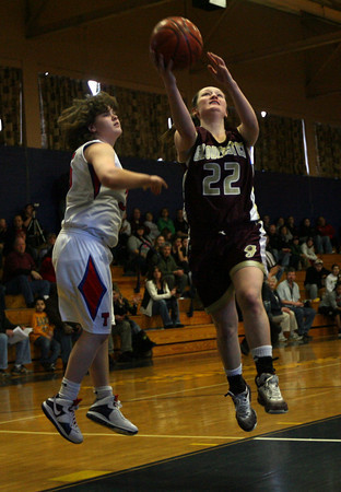 Lynn: Gloucester's Audrey Knowlton gets past Tewksbury's Chelsee Porcaro for a shot during the Spartan Classic at St. Mary's High School in Lynn yesterday. Photo by Kate Glass/Gloucester Daily Times