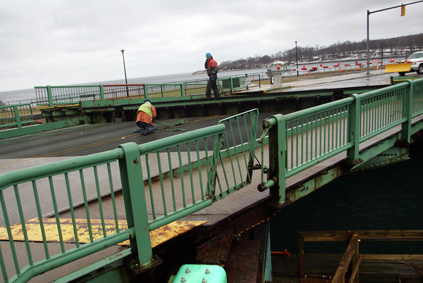 Gloucester: Crews work to fix the Blynman Bridge after it wouldn't close all the way and was stuck with about a two foot gap. Mary Muckenhoupt/Gloucester Daily Times