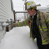 Gloucester: Gloucester Deputy Fire Chief Steve Aiello shows how close snow piles are getting to heating vents on houses, which when covered with snow can trap carbon monoxide in the home. The Fire Department is urging residents to clear their vents in addition to regular snow removal. Photo by Kate Glass/Gloucester Daily Times