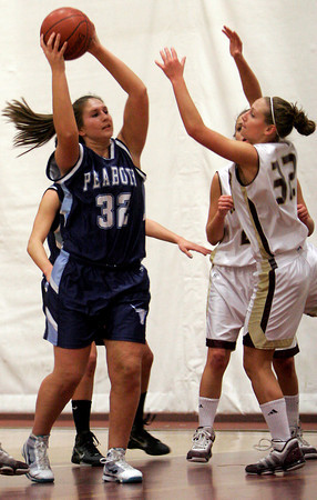 Peabody's Brittany LeFave tries to pass over Gloucester's Hannah Cain during their game at the Benjamin A. Smith Fieldhouse last night. Photo by Kate Glass/Gloucester Daily Times