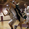 Rockport: Manchester Essex's Taylor Ketchum hauls in a rebound as Rockport's Jason Hendy reaches for the ball last night. Photo by Kate Glass/Gloucester Daily Times
