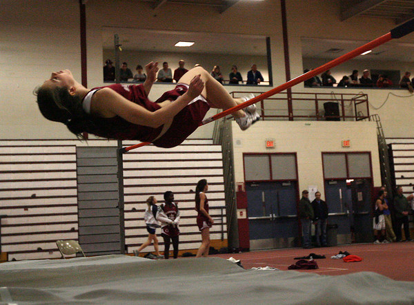 "Gloucester: Gloucester high jumper Tori Hilshey clears 5'0"" for the win during their meet against Peabody. It was Hilshey's second time clearing the height, a personal best. Photo by Kate Glass/Gloucester Daily Times"