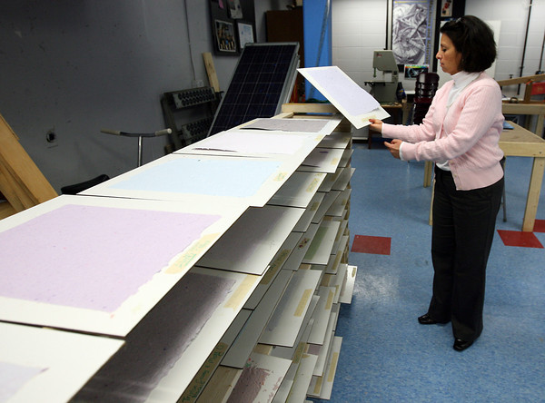 Gloucester: O'Maley Middle School Principal Deborah Lucey looks at samples of recycled paper that students made recently in the school's science center, which was funded through a grant from MIT. Photo by Kate Glass/Gloucester Daily Times