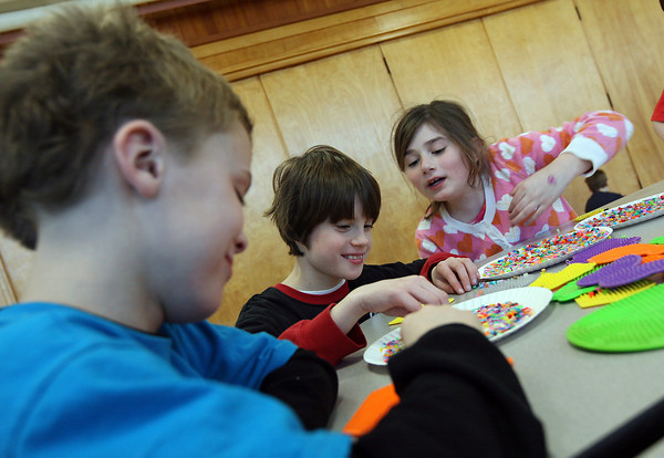Manchester: Tristan Novak, left, Jacob Hubbard, and Jenna Cirella work on a crafts project during the Hornets After School Program at Manchester Memorial Elementary School on Monday. Photo by Kate Glass/Gloucester Daily Times