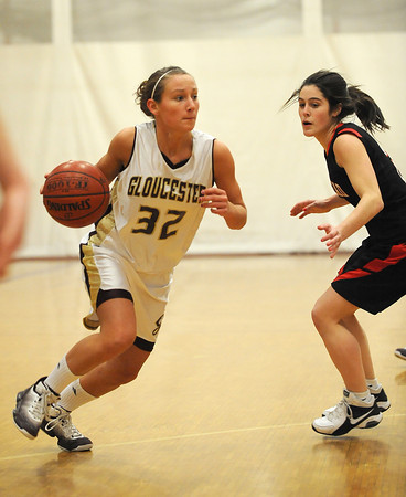 Gloucester: Gloucester's Hannah Cain breaks past a Marblehead player last night at the Benjamin A Smith Feildhouse. Desi Smith/Gloucester Daily Times. February 11,2011.