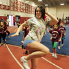 Gloucester: Varsity cheerleader Olivia Parsons, a nineth grader at Gloucester High School, leads a group of kids in a cheer during Cheerleading Mini Camp at Gloucester High School Thursday afternoon. Mary Muckenhoupt/Gloucester Daily Times